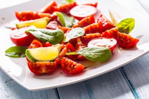 bigstock-Tasty-Tomatoes-Salad-With-Lime-253617796